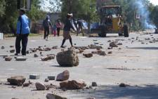 Khumalo Street was strewn with debris after scores of angry protesters took to the streets in Orlando West, in Soweto to protest against Eskom's pre-paid meters. Picture: Louise McAuliffe/EWN.