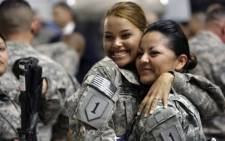 US soldiers smile for the camera.