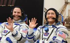 In this file photo taken on 14 March 2019 Nasa astronauts Christina Koch and Nick Hague, members of the International Space Station (ISS) expedition 59/60, react shortly before the launch onboard the Soyuz MS-12 spacecraft from the Russian-leased Baikonur cosmodrome in Kazakhstan. Picture: AFP