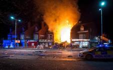 An explosion destroyed a convenience store and a home in the central English city of Leicester on 25 February 2018, injuring at least six people. Picture: Supplied.