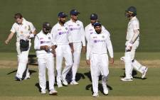 India's captain Virat Kohli (2/R) leads his players off the field after their loss to Australia on the third day of the first cricket Test match between Australia and India played in Adelaide on 19 December 2020. Picture: AFP