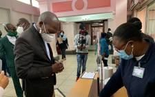 Health Minister Zweli Mkhize (L) arriving at the Tshwane District Hospital on 10 July 2020 to assess preparedness for the surge in COVID-19 infections in Gauteng. Picture: @DrZweliMkhize/EWN