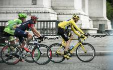 Christopher Froome races towards a second Tour de France victory in Paris on 26 July 2015. Picture: Thomas Holder/EWN
