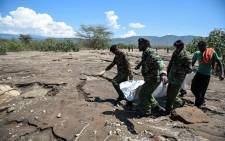 Rescue team carry bodies of 7 tourists retrieved at Suswa area of Nakuru County on 2 September 2019 after they were swept by flash floods the day before inside while hiking a gorge at Hells Gate National Park in Naivasha, Nakuru. Pictures: AFP.