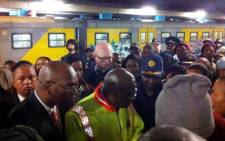 Police Minister, Nathi Mthethwa listens to commuters' complaints about safety on trains at Cape Town station.