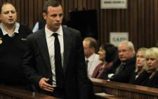 Oscar Pistorius walks past June Steenkamp as he entered Pretoria High Court ahead of the first day of his murder trial on 3 March 2014. Picture: Sapa.