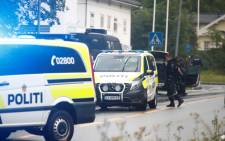 A picture taken on 10 August 2019 shows police vehicles near the al-Noor islamic center mosque where a gunman, armed with multiple weapons, went on a shooting spree in the town of Baerum, an Oslo suburb. The gunman injured one worshipper before being arrested, police and witnesses said. Picture: AFP