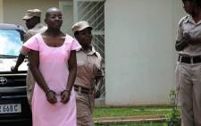 FILE: Rwandan opposition leader, Victoire Ingabire is led to the Rwandan High Court as the fourth week of her trial begins in Kigali, Rwanda September 12, 2011. Picture: AFP.
