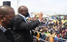 President Cyril Ramaphosa waves to Katlehong residents during the launch of the Vooma Vaccination Weekend drive on 1 October 2021. Picture: @PresidencyZA/Twitter