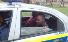 A suspect, arrested at the scene of a shootout with police in Kempton Park, on 15 January 2013, in which two officers were wounded. Picture: Shain Germaner/EWN.