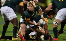 FILE: South Africa's Faf de Klerk makes a pass during the rugby Test match between New Zealand and South Africa at AMI Stadium in Christchurch on 17 September 2016. Picture: AFP.
