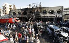 FILE: Lebanese civilians gather at the site of a blast outside the Al-Taqwa Mosque in Tripoli on 23 August 2013. Picture: AFP.