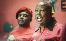 EFF leader Julius Malema addresses the media following the Constitutional Court's ruling that President Jacob Zuma must pay back some of the money spent on upgrades to his Nkandla homestead. Picture: Reinart Toerien/EWN.
