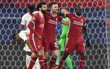 Liverpool's Mohamed Salah (L) celebrates with teammates Diogo Jota (C) and Sadio Mane after scoring his team's first goal during the UEFA Champions league Last 16 2nd Leg football match between Liverpool and RB Leipzig at Puskas Arena in Budapest, Hungary, on 10 March 2021. Picture: Attila Kisbenedek/AFP