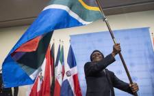 Jerry Matjila waves his SA's flag during the flag installation ceremony held to honour the newly-elected non-permanent members of the Security Council for the term 2019-2020. Picture: United Nations Photo.