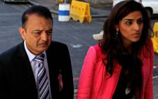 FILE: Anni Dewani's father Vinod Hindocha is seen with a relative outside the Western Cape High Court on Monday 27 August 2012 at the trial of Dewani's alleged killer. Picture: Sapa.