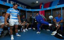 Diego Maradona entertains and encourages the Argentinian team as he juggles a rugby ball in the dressing room after the win over Tonga. Picture: Rugbyworld.com