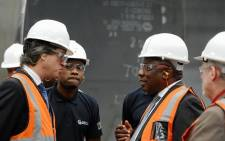 President Cyril Ramaphosa joined by Minister Rob Davies of Trade and Industry conducted on a guided tour of the GRI Towers factory that forms part of the special economic zone (SEZ) being launched in Atlantis, Western Cape on 6 December 2018. Picture: @PresidencyZA/Twitter