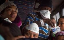 Evacuees from Buffalo Bay stay on a bus during high winds and smoke near the coastline while waiting for fires to pass. Picture: Thomas Holder/EWN.