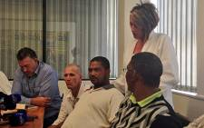 Carina Papenfus and farm workers who allege they were assaulted by a farm manager. Picture: Rahima Essop/EWN