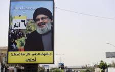 A portrait of chief of the Lebanese Hezbollah movement, Hassan Nasrallah, on the side of a road in the mainly Shi'ite Muslim southern suburbs of Beirut on 4 May 2018. Picture: AFP.