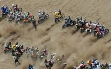 Motorcycles and quad bikes line up at the start of stage nine of the 2011 Dakar Rally. Dakar 2014 sees the youngest rider ever taking part