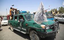 Taliban fighters patrol the streets of Kabul on 16 August 2021, after a stunningly swift end to Afghanistan's 20-year war, as thousands of people mobbed the city's airport trying to flee the group's feared hardline brand of Islamist rule. Picture: Wakil Kohsar/AFP