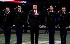 US President Donald Trump on the field during the national anthem prior to the CFP National Championship presented by AT&T between the Georgia Bulldogs and the Alabama Crimson Tide at Mercedes-Benz Stadium on 8 January 2018, in Atlanta, Georgia. Picture: AFP