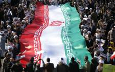 FILE: Iranians carry a giant flag. Picture: AFP