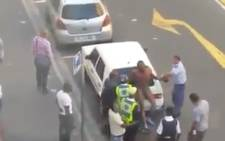 David Gunn and Gerrit Januarie were identified in video footage in Cape Town's city centre in March. Picture: YouTube.com
