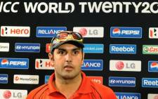 Afghanistan cricketer Mohammad Nabi talks to the media during the open media sessions ahead of the ICC Twenty20 Cricket World Cup in Colombo on September 13, 2012. Picture: AFP.