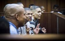 An alleged leader of the 28s gang, George Thomas and his 17 co-accused in court on 4 May 2015, they collectively face 166 charges ranging from murder to attempted murder. Picture: Thomas Holder/EWN.