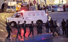Israeli security forces and an ambulance are seen at the scene of an attack outside Damascus Gate in Jerusalem's Old City on 16 June 2017. Picture: AFP.