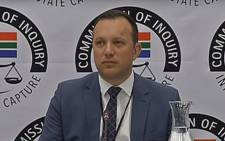 A screengrab of journalist Adriaan Basson appearing at the Zondo Commission on 5 February 2019.