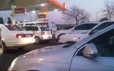 Cars queue for petrol at one of the few stations in Midrand, Johannesburg that still had stock during the Ceppwawu strike on Friday 15 July 2011. Picture: Martha Sello/iWitness