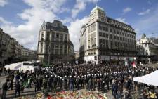 Anti-riot police officers surround protesters who disturbed a tribute to the victims of terror attacks on Place de la Bourse in Brussels on 27 March 2016. Picture: AFP.