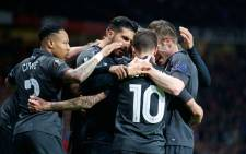 Liverpool players congradulate teamamte Philippe Coutinho after scoring against Manchester United in the Europe League match on 17 March 2016. Picture: Liverpool FC Facebook page.