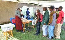 FILE: Residents queue to vote at a polling station during the local elections in the town of Arusha, north Tanzania, on 24 November 2019. Picture: AFP