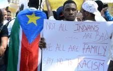 Members of the African Students Association hold placards during a protest in Hyderabad on February 6, 2016, in support of Tanzanian nationals assaulted by a local mob in Bangalore. Indian authorities suspended two policemen and made four more arrests over a mob attack on a Tanzanian student in Bangalore, police said February 5, in a case that has caused widespread outrage. Picture: AFP.