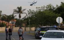 Police on the scene of the hostage situation in Moreleta Park. Picture: Christa Eybers/EWN.