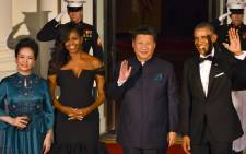 US President Barack Obama and US First Lady Michelle welcome Chinese President Xi Jinping and his wife Peng Liyuan for a State Dinner at the White House on 25 September, 2015 in Washington, DC. Picture: AFP.