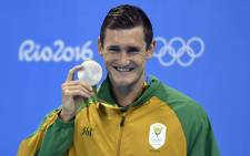 Cameron van der Burgh poses on the podium after he won the silver medal in the Men's 100m Breaststroke Final during the swimming event at the Rio 2016 Olympic Games at the Olympic Aquatics Stadium in Rio de Janeiro on 7 August, 2016. Picture: AFP.