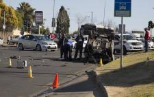 One person has been killed and three people injured during a high speed chase and shootout between suspects and police in Sandton. Picture: Christa Eybers/EWN