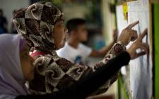 Muslim women look for their names at a voting precinct in Maguindanao, on the southern island of Mindanao on 21 January 2019, the plebiscite to ratify the passage of the Bangsamoro Organic Law (BOL). Picture: AFP