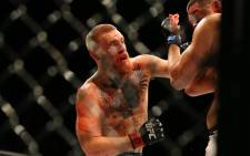 FILE: Conor McGregor punches Nate Diaz during UFC 196 at the MGM Grand Garden Arena on 5 March, 2016 in Las Vegas, Nevada. Picture: AFP.