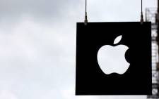 The Apple logo hangs in front of an Apple store on July 23, 2013 in New York City. Picture: Spencer Platt/AFP