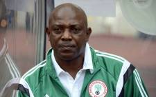 A file picture showing former Nigeria Nigeria's coach Stephen Keshi looking on during the 2015 Africa Cup of Nations qualifying football match between Nigeria and Sudan on 15 October, 2014 in Abuja. Picture: AFP.