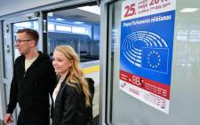 A couple arrives at a polling station in Riga, Latvia, take part in the European Elections on May 25, 2019. Picture: AFP.