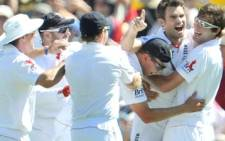 James Anderson is congratulated by teammates after dismissing Australian captain Ricky Ponting on the 1st day of the 2nd Ashes cricket Test match. Picture: AFP