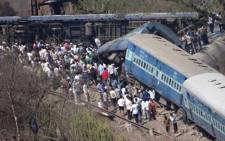 Mangled train coaches near Nidi village after the train derailed in Raigad district of India's Maharashtra state on 4 May, 2014. Picture: AFP.